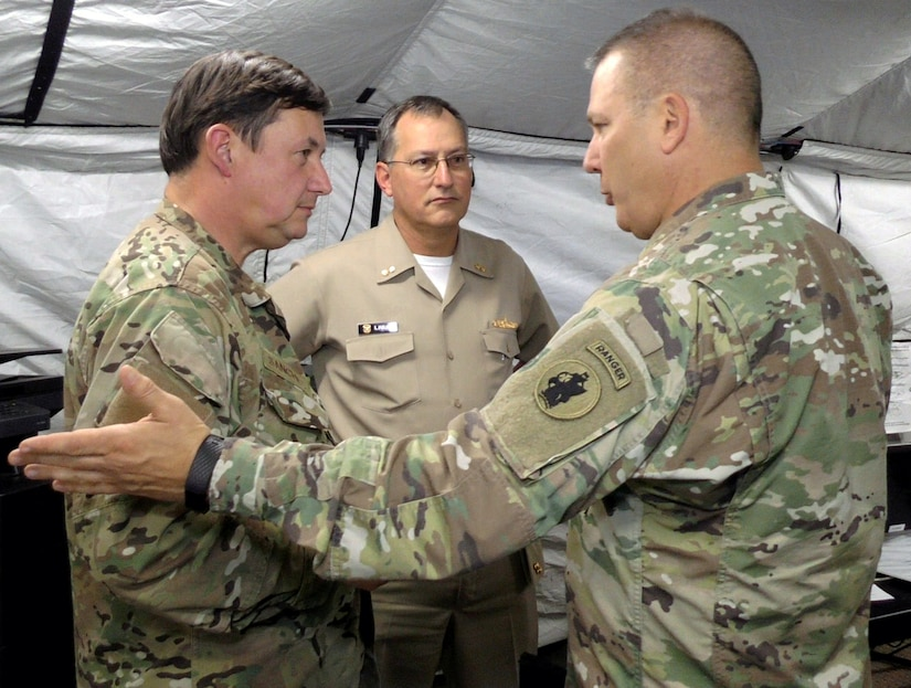 (Right to left) Maj. Gen Mark Stammer, commander, U.S. Army South; Rear Adm. Luis Figari, Peruvian Navy; and Rear Adm. Luis Sanchez, Chilean Navy interact at the Multinational Forces South Joint Contingency Command Post at Joint Base San Antonio-Fort Sam Houston during Operation Futuro Noble Aug. 8.