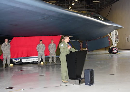 """Lt. Col. Timothy Rezac, commander of the 110th Bomb Squadron, a subordinate unit of the Missouri Air National Guard's 131st Bomb Wing, addresses the audience prior to the unveiling of a new paint scheme with the slogan """"Lindbergh's Own"""" on a gear door for the Spirit of Nebraska, a B-2 bomber, at Whiteman Air Force Base, Missouri, Aug. 4, 2018. The slogan commemorates the late Charles A. Lindbergh, the unit's most famous member. (U.S. Air National Guard photo by Senior Master Sgt. Mary Dale Amison)"""