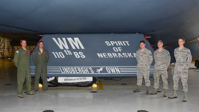 "The dedicated pilots and aircraft crew chiefs for the Spirit of Nebraska, a B-2 bomber, gather after a new paint scheme with the slogan ""Lindbergh's Own"" on a gear door was unveiled at Whiteman Air Force Base, Missouri, Aug. 4, 2018. The slogan is associated with the 110th Bomb Squadron, a subordinate unit of the Whiteman based 131st Bomb Wing, and commemorates the late Charles A. Lindbergh, the unit's most famous member."