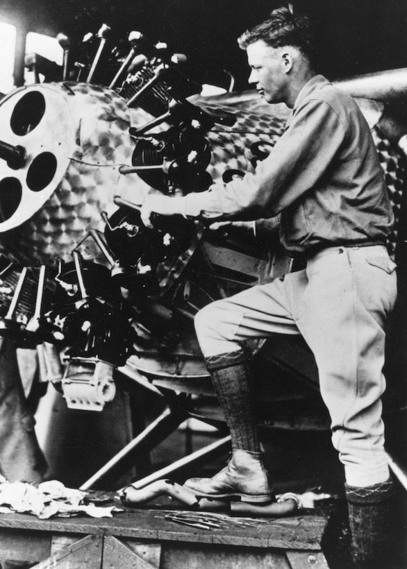 "Capt. Charles A. Lindbergh performs maintenance on the Spirit of St. Louis. Lindbergh flew the aircraft in a transatlantic flight from in 1927, completing the first nonstop flight between New York to Paris. Lindbergh's military service included being a member of the Missouri National Guard's 110th Observation Squadron, which today is the 110th Bomb Squadron at Whiteman Air Force Base, Missouri, and is known as ""Lindbergh's Own."" (131st Bomb Wing archive photo)"