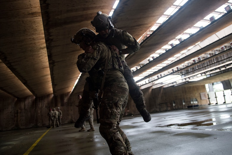 A joint terminal attack controller (JTAC) from the 18th Air Support Operations Group carries a fellow JTAC during Draco Spear, Aug. 3, 2018, at Moody Air Force Base, Ga. Draco Spear is a revival of the mid-2000s joint-training event Dragon Challenge that tested the top JTACs from various air support operations squadrons both mentally and physically. (U.S. Air Force photo by Senior Airman Janiqua P. Robinson)