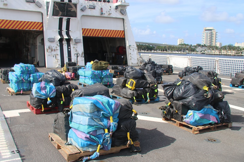 An estimated 12,500 pounds of cocaine and 50 pounds of marijuana lie on pallets onboard the Coast Guard Cutter Hamilton Aug. 1, 2018, in Port Everglades