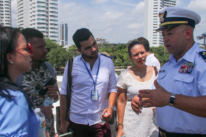 Chief Warrant Officer Miguel Felix explains the Coast Guard Cutter Hamilton's capabilities to members of the Colombian media July 25, 2018, during Sail Cartagena de Indias 2018 in Cartagena, Colombia.