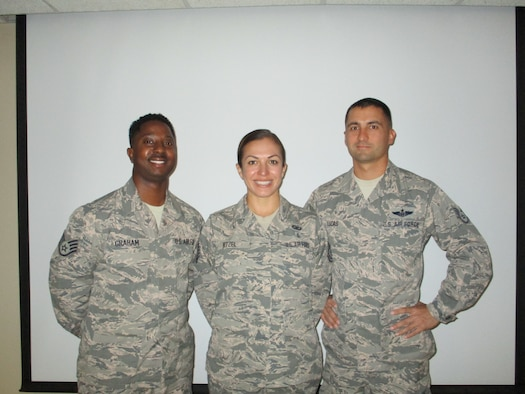 Staff Sgt. Germaine Graham, Tech. Sgt. Erin Nitzel, and Staff Sgt. Nick Lucas stand for a photo Aug. 8, 2018, at Tinker Air Force Base, Oklahoma. Graham, Nitzel and Lucas are the three newest members of the 513th Air Control Group safety office at Tinker Air Force Base, Oklahoma. (U.S. Air Force photo by Master Sgt. Andy Stephens)