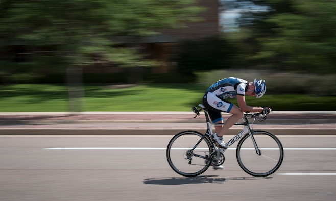 PETERSON AIR FORCE BASE, Colo. – A participant in the 21st Space Wing Sports & Field Day cycles at Peterson Air Force Base, Colorado, July 12, 2018. Airmen and civilians at Peterson AFB bike for exercise, recreation and commuting and are required to wear a helmet while operating human powered vehicles on the installation. (U.S. Air Force photo by 2nd Lt. Justin Davidson-Beebe)