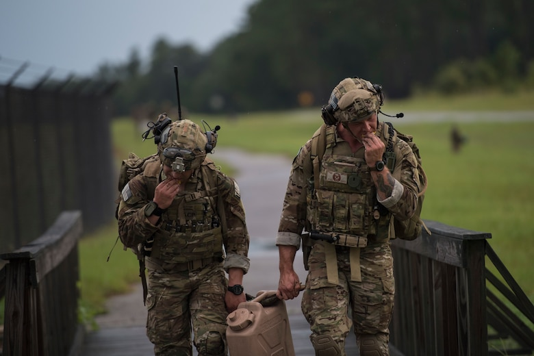 Staff Sgt. Ryan Holst, left, and Tech. Sgt. Ryan Shipman, both 19th Air Support Operations Squadron joint terminal attack controllers (JTAC), grab a quick bite while executing a ruck march during Draco Spear, Aug. 3, 2018, at Moody Air Force Base, Ga. Draco Spear is a revival of the mid-2000s joint-training event Dragon Challenge that tested the top JTACs from various air support operations squadrons both mentally and physically. (U.S. Air Force photo by Senior Airman Janiqua P. Robinson)