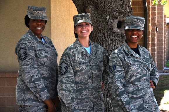U.S. Air Force Master Sgt. Christine Austin, 316th Training Squadron flight chief, Master Sgt. Erin Weiss, 316th TRS flight chief, and Staff Sgt. Sabrina Scruggs, 315th Training Squadron instructor, stand outside of Smoothies & Things after a meeting on Goodfellow Air Force Base, July 20, 2018. These three individuals are the team responsible for coordinating a new program that allows Goodfellow Airmen to attend events and receive mentorship about a variety of subjects relating to their career in the Air Force. (U.S. Air Force photo by Airman 1st Class Seraiah Hines/Released)