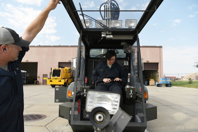Senior Airman Rebecca English, a 28th Logistics Readiness Squadron vehicle maintenance technician, prepares to operate a deicing machine at Ellsworth Air Force Base, S.D., Aug. 9, 2018. Members of the 28th LRS vehicle maintenance shop perform a rebuild during the summer months on all the base's snow fleet vehicles to ensure they are ready to operate effectively when winter arrives. (U.S. Air Force photo by Airman 1st Class Thomas Karol)