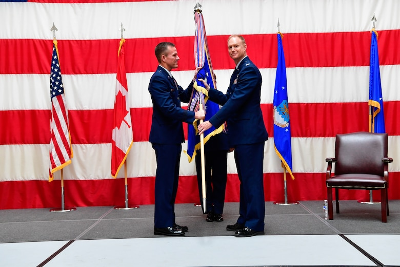 Col. Gregory Lewis (right) accepts command of the Western Air Defense Sector from the assumption of command presiding officer, Brig. Gen. Kenneth Ekman, First Air Force and Air Forces Northern Command vice commander, at the Washington Army National Guard Readiness Center, Joint Base Lewis-McChord, July 31, 2018.