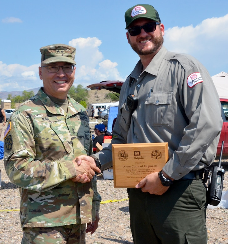 Maj. Gen. Keith Nava, National Guard adjutant and commander, thanks USACE park ranger Wesley Myers for the Corps' participation in the National Guard's 4th Annual Card-board Regatta held July 27, 2018, at Cochiti Lake.