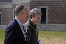 The Honorable Heather A. Wilson, the Secretary of the Air Force, walks next to the Honorable Dan Sullivan, a United States senator from Alaska, Aug. 10, 2018, at Eielson Air Force Base, Alaska. Wilson held a town hall for 354th Fighter Wing Airmen in the base's theater. (U.S. Air Force photo by Airman 1st Class Eric M. Fisher)