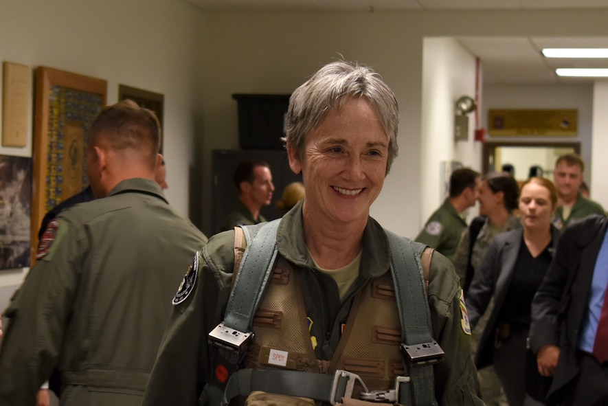 The Honorable Heather A. Wilson, the Secretary of the Air Force, smiles while walking out of the 18th Aggressor Squadron, Aug. 10, 2018, at Eielson Air Force Base, Alaska. Shortly after, Wilson flew in one of the 18th AGRS F-16 Fighting Falcons. (U.S. Air Force photo by Airman 1st Class Eric M. Fisher)