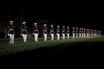 U.S. Marines with the Silent Drill Platoon perform during an evening parade at Marine Barracks Washington, D.C., Aug. 10, 2018. Richard V. Spencer, Secretary of the Navy, was the honored guest at this evening's parade.