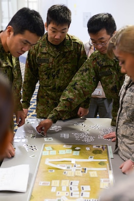 Japanese Ground Defense Forces demonstrate their plans to set up a decontamination area during a tabletop simulation at Yokota Air Base, Japan, August 8, 2018.
