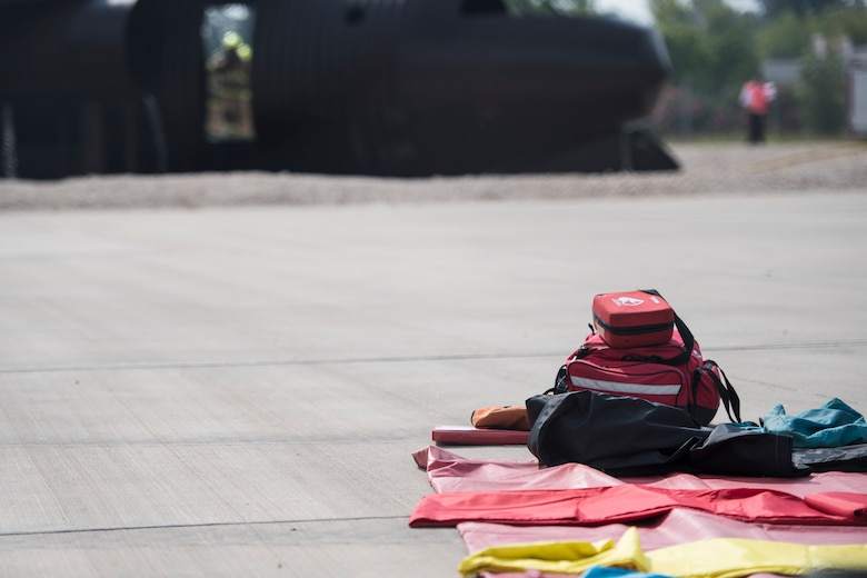 Equipment for simulated casualties lays ready during a simulated aircraft fire