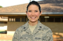 """U.S. Air Force Capt. Kelli Marietta, the officer in charge for the Molokai team for Tropic Care Maui County 2018, poses for a portrait photo at the Mitchell Pauole Center, Molokai, Hwaii, Aug. 18, 2018. Tropic Care Maui County 2018 provides medical service members and support personnel """"hands-on"""" readiness training to prepare for future deployments while providing direct and lasting benefits to the people of Maui, Molokai, and Lanai, August 11-19. She assisted at a serious car wreck until EMS personnel arrived."""