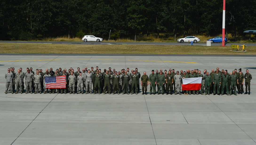 U.S. and Polish air force members pose for a group photo on Powidz Air Base, Poland, Aug. 9, 2018 (U.S. Air Force photo by Senior Airman Joshua Magbanua)