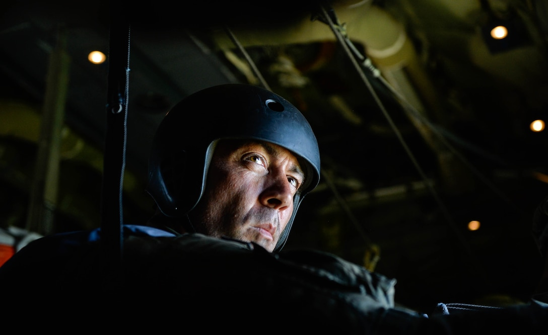 A Polish military parachute instructor prepares to drop his paratroopers from a U.S. Air Force C-130J Super Hercules over Poland Aug. 7, 2018. U.S. Airmen assigned to the 86th Airlift Wing and U.S. Soldiers assigned to the 5th Quartermaster worked with their Polish partners to airdrop paratroopers during the annual Aviation Rotation bilateral exercise. (U.S. Air Force photo by Senior Airman Joshua Magbanua)