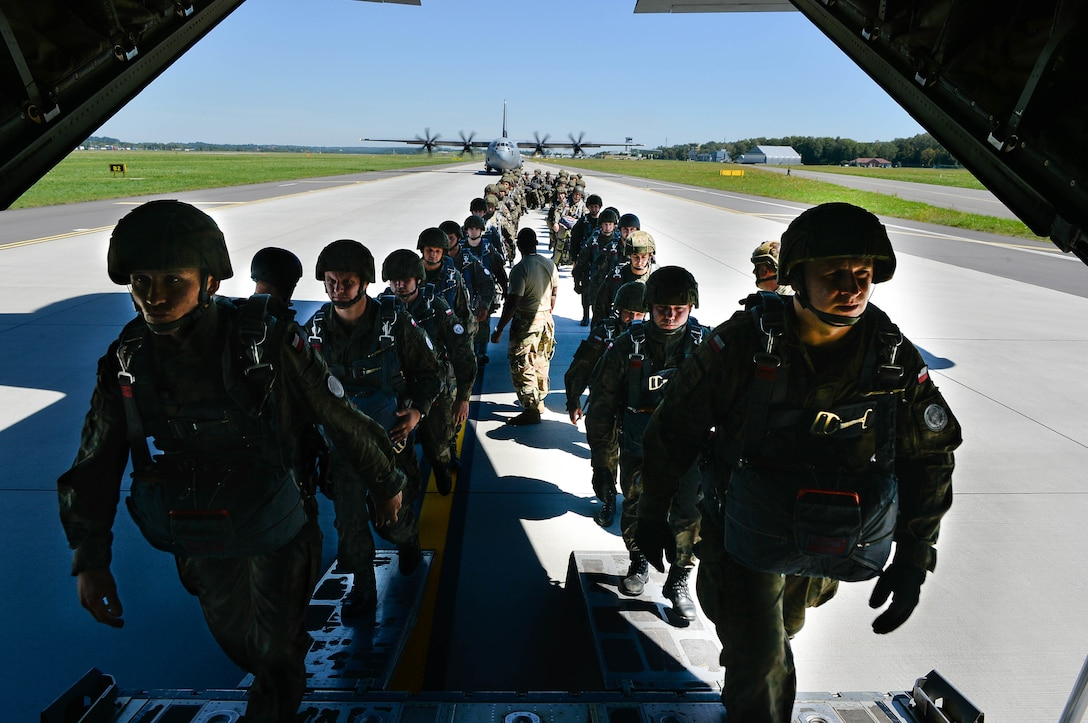 Polish paratroopers sit down after boarding a U.S. Air Force C-130J Super Hercules during Exercise Aviation Rotation 18-4 at Krakow, Poland, Aug. 7, 2018. The airdrop operations conducted during Aviation Rotation were static line jumps and High Altitude-Low Opening jumps. (U.S. Air Force photo by Senior Airman Joshua Magbanua)