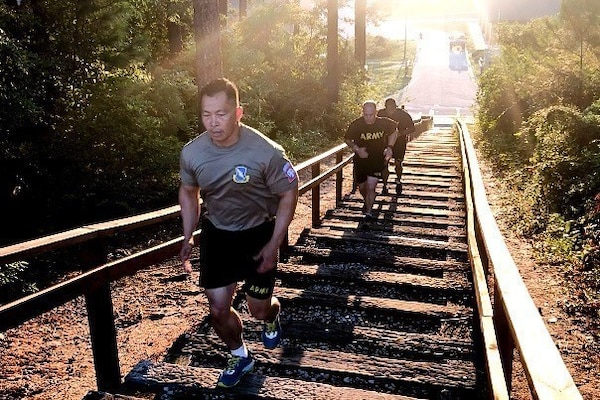 Army Command Sgt. Maj. Thinh Huynh runs stairs during physical training at Fort Bragg, N.C., Aug. 1, 2018. Army photo by Spc. Alleea Oliver