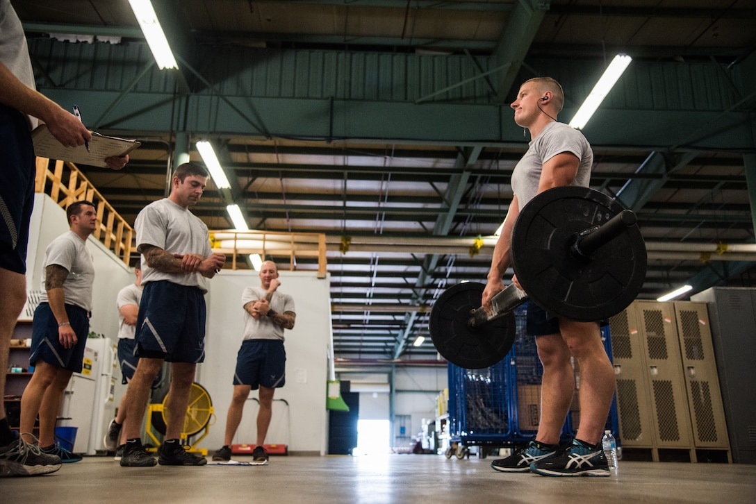 Airman 1st Class Jevon Weixler, an 87th Civil Engineer Squadron Explosive Ordnance Disposal apprentice at Joint Base McGuire-Dix-Lakehurst, N.J., performs the Grip Endurance component of the EOD Tier 2 Physical Fitness Test Prototype at Dover Air Force Base, Del., Aug. 8, 2018. The Air Force Exercise Science Unit administered the EOD Tier 2 test prototype to EOD leaders and technicians during a two-day training event.  (U.S. Air Force photo by Staff Sgt. Damien Taylor)