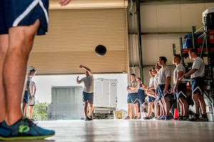 Explosive Ordnance Disposal Airmen perform the Medicine Ball Toss component of the EOD Tier 2 Physical Fitness Test Prototype at Dover Air Force Base, Del., Aug. 8, 2018. EOD Airmen assigned to units in nine states participated in the EOD prototype test. (U.S. Air Force photo by Staff Sgt. Damien Taylor)