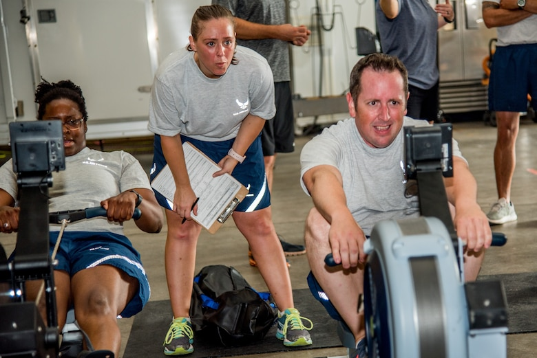 Explosive Ordnance Disposal Airmen perform the Row Ergometer 1,000 meter component of the EOD Tier 2 Physical Fitness Test Prototype at Dover Air Force Base, Del., Aug. 8, 2018. The Row Ergometer 1,000 meter measures the muscular endurance, anaerobic capacity and cardiorespiratory endurance of EOD technicians. (U.S. Air Force photo by Staff Sgt. Damien Taylor)