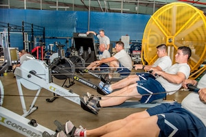 Explosive Ordnance Disposal Airmen perform the Row Ergometer 1,000 meter component of the EOD Tier 2 Physical Fitness Test Prototype at Dover Air Force Base, Del., Aug. 8, 2018. The Row Ergometer 1,000 meter is one of 10 test components administered during the Tier 2 test prototype. (U.S. Air Force photo by Staff Sgt. Damien Taylor)