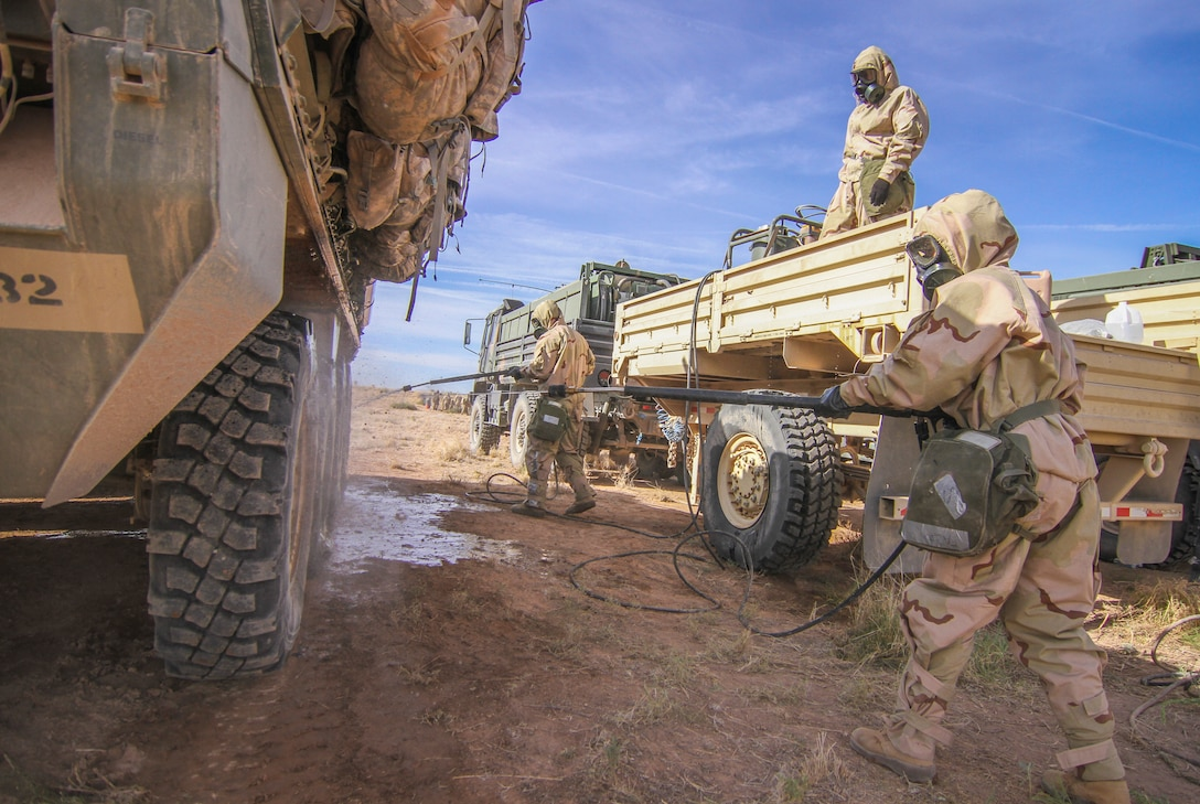 Army Reserve Soldiers conduct decontamination operations with 1st Armored Division