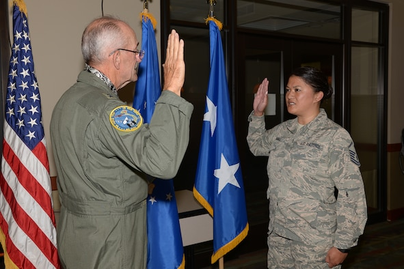 Retired Air Force Maj. Gen. Edward Mechenbier re-enlists his daughter, Master Sgt. Kari Eubanks, Air Force Reserve, 302nd Force Support Squadron, at Peterson Air Force Base, Colorado, Aug. 5, 2018.