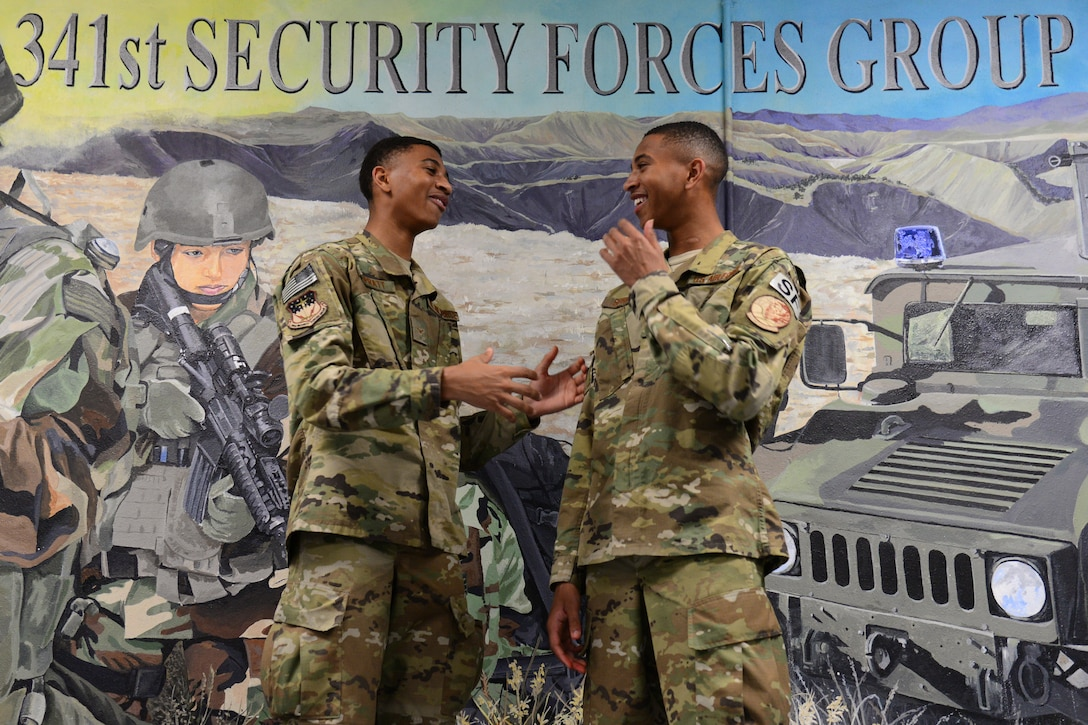 Airman 1st Class Leland, left, and Airman 1st Class Lemuel Spratt, 341st Missile Security Forces Squadron members, share a joke July 19, 2018, at Malmstrom Air Force Base, Mont.