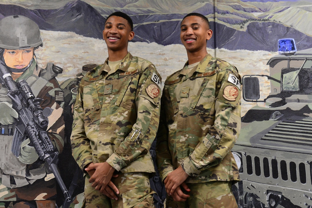 Airman 1st Class Leland, left, and Airman 1st Class Lemuel Spratt, 341st Missile Security Forces Squadron members, pose for a portrait July 19, 2018, at Malmstrom Air Force Base, Mont.