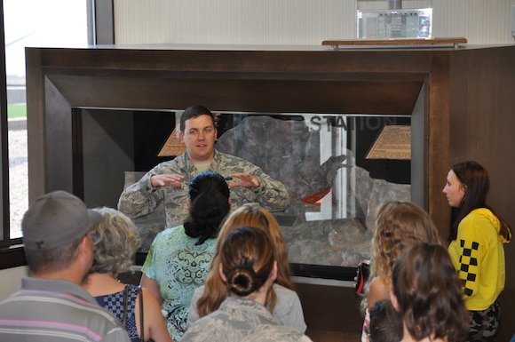 Staff Sgt. Evan Gable explains how the Cheyenne Mountain Complex was built inside a mountain during the Cold War. Spouses and significant others from the 14th Test Squadron toured the secretive base August 4, 2018.