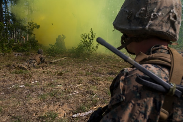 Marines from India Company, 3rd Battalion, 25th Marine Regiment, observe as combat engineers clear an obstacle during a live-fire range at Camp Grayling, Mich., Aug. 8, 2018. Northern Strike's mission is to exercise participating units' full-spectrum of capabilities through realistic, cost-effective joint fires training in an adaptable environment, with an emphasis on joint and coalition force cooperation. (U.S. Marine Corps photo by Cpl. Niles Lee)