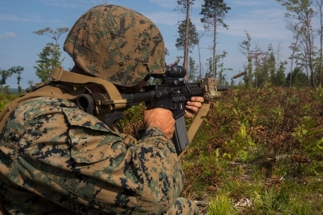 A Marine from India Company, 3rd Battalion, 25th Marine Regiment, fires at an enemy target during a live-fire range at Camp Grayling, Mich., Aug. 8, 2018. Northern Strike's mission is to exercise participating units' full-spectrum of capabilities through realistic, cost-effective joint fires training in an adaptable environment, with an emphasis on joint and coalition force cooperation. (U.S. Marine Corps photo by Cpl. Niles Lee)