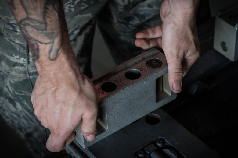 A U.S. Airman assigned to the 77th Aircraft Maintenance Unit applies roller extenders to a bomb loader at Shaw Air Force Base, S.C., Aug. 8, 2018.