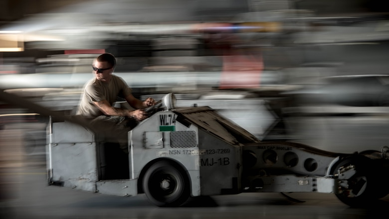 U.S. Air Force Senior Airman James Bridge, 77th Aircraft Maintenance Unit load crew team member, operates a bomb loader at Shaw Air Force Base, S.C., Aug. 9, 2018.