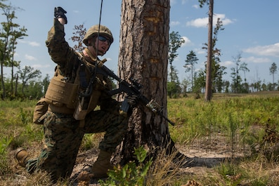 Sgt. Jordan Fleenor, a squad leader with India Company, 3rd Battalion, 25th Marine Regiment, communicates to his Marines during a live-fire range at Camp Grayling, Mich., Aug. 8, 2018. Exercise Northern Strike is a National Guard Bureau-sponsored training exercise that unites service members from multiple branches, states and coalition countries to conduct combined ground and air combat operations. (U.S. Marine Corps photo by Cpl. Niles Lee)