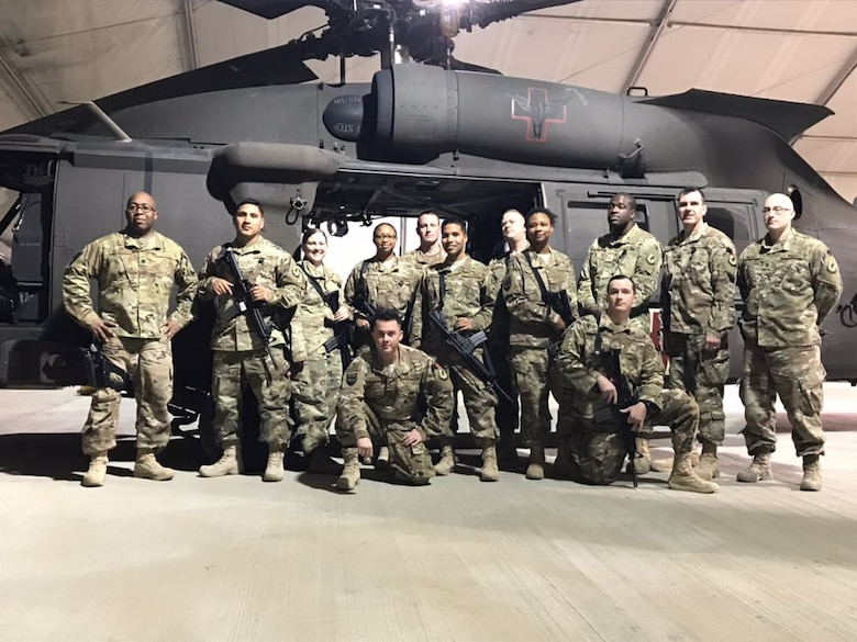 Lt. Col. Patrick Kennedy, 60th Medical Group, poses with members of the Diagnostic and Therapeutic Flight in front a U.S. Army UH-60 Black Hawk medical evacuation helicopter at Bagram Airfield, Afghanistan, during a deployment October 2017 to May 2018.  (Courtesy photo)
