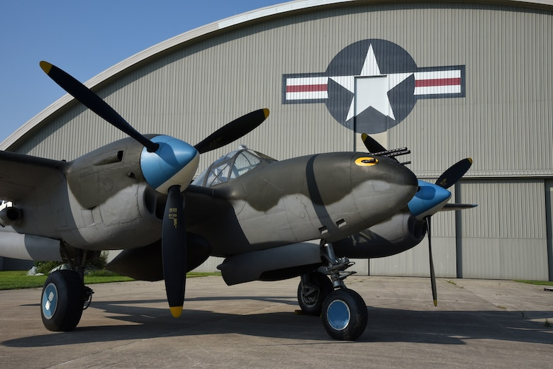 A view of the Lockheed P-38L Lightning before being towed to the WWII Gallery at the National Museum of the U.S. Air Force on Aug. 13, 2018. Several WWII era aircraft on display were temporarily placed throughout the museum to provide adequate space for the Memphis Belle exhibit opening events. (U.S. Air Force photo by Ken LaRock)