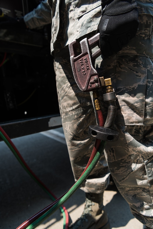 Airman 1st Class Heather Manzanares, 9th Logistics Readiness Squadron petroleum, oil and lubricants operator squeezes a trigger enabling the flow of fuel at Beale Air Force Base, California, Aug. 9, 2018. POL Airmen are responsible for providing fuel to the U-2 Dragon Lady, RQ-4 Global Hawk, T-38 Talon and KC-135 Stratotanker. (U.S. Air Force photo by Senior Airman Justin Parsons)