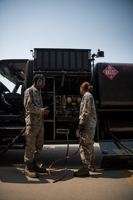 Airman 1st Class Heather Manzanares and Wilson control and monitor the flow of fuel during operations at Beale Air Force Base, California, Aug. 9, 2017