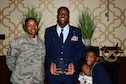 Master Sgt. Demetrius, 432nd Wing inspection superintendent, poses with his wife, son and daughter after receiving the 2017 Senior Master Sgt. Margaret Frances Barbour Award at the Military Diversity Luncheon in Las Vegas, Aug. 9, 2018. These awards were named after Tuskegee Airmen and those who receive them uphold the passion, determination and innovation of the Airmen who flew before them. (U.S. Air Force photo by Airman 1st Class Haley Stevens)