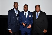 Master Sgt. Demetrius (center), 432nd Wing inspection superintendent, is presented with the 2017 Senior Master Sgt. Margaret Frances Barbour Award by Leon A. Johnson (left), national president of the Tuskegee Airmen Incorporated and Clarence A. Johnson (right), Washington D.C. Department of Defense Office of Diversity Management and Equal Opportunity Director, at the Military Diversity Luncheon in Las Vegas, Aug. 9, 2018. This award is named after a Tuskegee Airman and is presented to remarkable Airmen who have dedicated themselves to being a mentor in their local and Air Force communities. (U.S. Air Force photo by Airman 1st Class Haley Stevens)