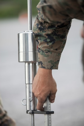 Cpl. Steve Anderson, a refueler with Marine Wing Support Squadron 471, 4th Marine Aircraft Wing uses the dynamic cone penetrometer to test the density of the 2,000-foot runway extension during Innovative Readiness Training Old Harbor, Aug. 6, 2018. The IRT program supports troops' readiness to fight through training, while serving American communities. (U.S. Marine Corps photo by Lance Cpl. Tessa D. Watts)