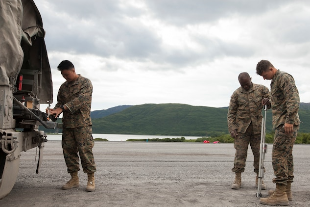 Cpl. Miky Vilaysane, a refueler with Marine Wing Support Squadron 471, 4th Marine Aircraft Wing, Cpl. Aziz Sumo, a mechanic with MWSS-471, and Cpl Steve Anderson, a refueler with MWSS-471, operate the dynamic cone penetrometer to test the density of the 2,000-foot runway extension during Innovative Readiness Training Old Harbor, Aug. 6, 2018. The IRT program supports troops' readiness to fight through training, while serving American communities. (U.S. Marine Corps photo by Lance Cpl. Tessa D. Watts)