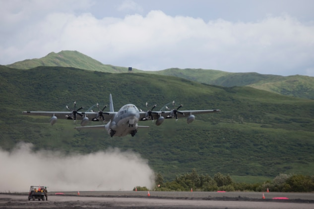 Col. Charles Moses, the commanding officer of Marine Air Group 41, 4th Marine Aircraft Wing lands a C-130 during Innovative Readiness Training Old Harbor, Alaska, Aug. 6, 2018. This year marks the completion of the 2,000-foot extension of Old Harbor's runway. (U.S. Marine Corps photo by Lance Cpl. Tessa D. Watts)