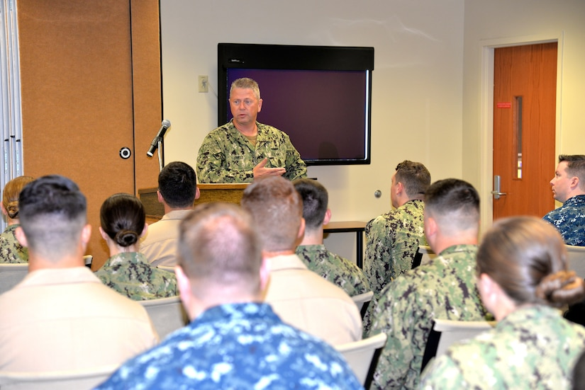Navy Medicine East Command Master Chief Michael Hinkle speaks to Sailors of Naval Health Clinic Charleston Aug. 7, 2018, about the future of military medicine.