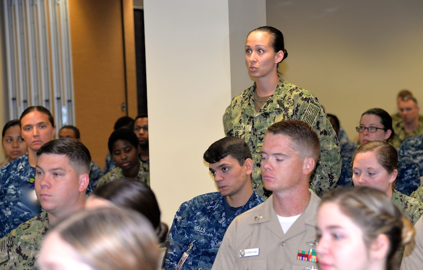Petty Officer 2nd Class Lauren Pereda, a hospital corpsman serving at Naval Health Clinic Charleston and NHCC's career counselor, highlights the goals of NHCC's newly created mentorship program for Navy Medicine East Command Master Chief Michael Hinkle during his visit to the clinic Aug. 7, 2018.