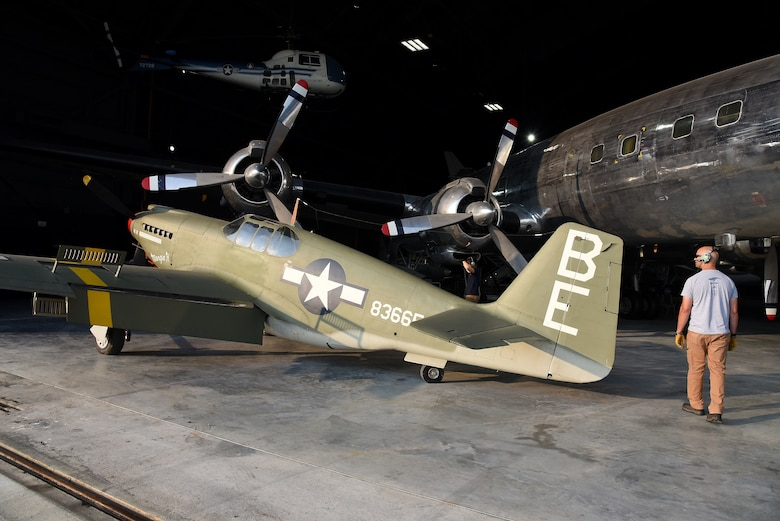 Museum restoration crews prepare to move the North American A-36A Apache back into the WWII Gallery at the National Museum of the U.S. Air Force on Aug. 13, 2018. Several WWII era aircraft were temporarily placed throughout the museum to provide adequate space for the Memphis Belle exhibit opening events. (U.S. Air Force photo by Ken LaRock)